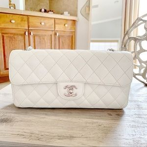 614a9bd84ab4 CHANEL. Chanel White Caviar East West Flap SHW